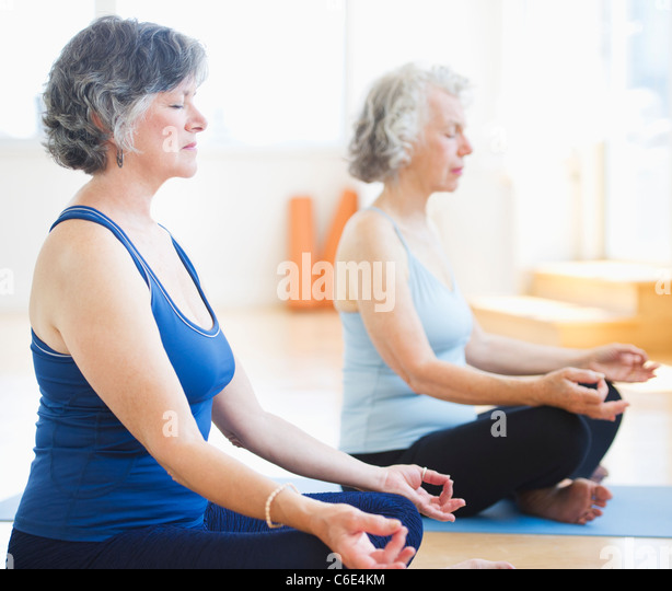 USA, New Jersey, Jersey City, Two senior women practicing yoga - Stock-Bilder