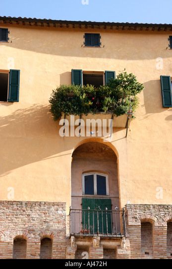 Houses are built on top of the historic wall around the  medieval town of Jesi in Le Marche Italy - Stock Image