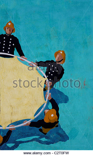 Firemen holding rescue trampoline - Stock Image