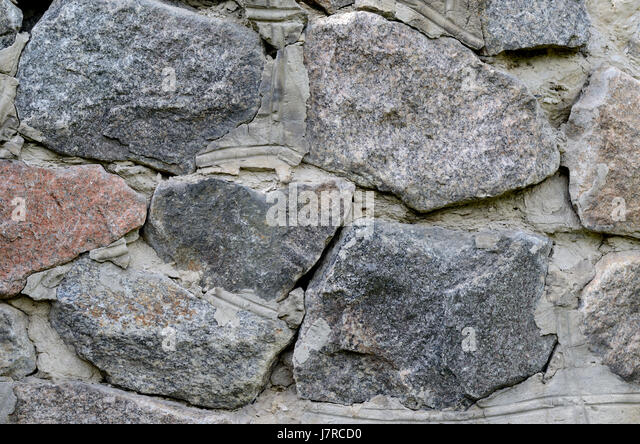 Huge Granite Stone : Huge stone wall texture background stock photos