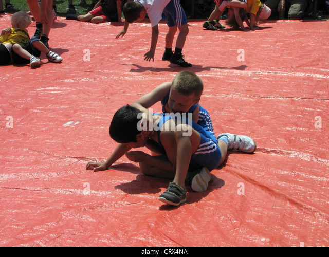 Outdoor Sport Boys wrestling  - Stock Image