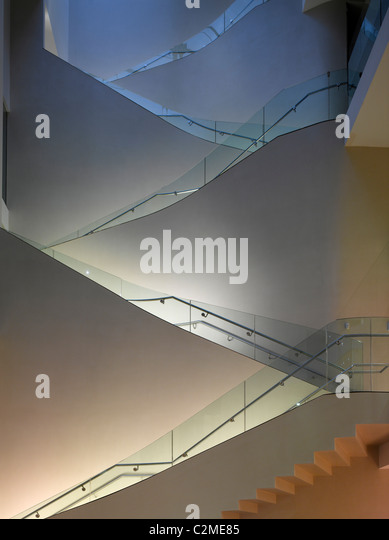 Ashmolean Museum Extension, Oxford. Zig zag staircase with glass and handrails - Stock Image