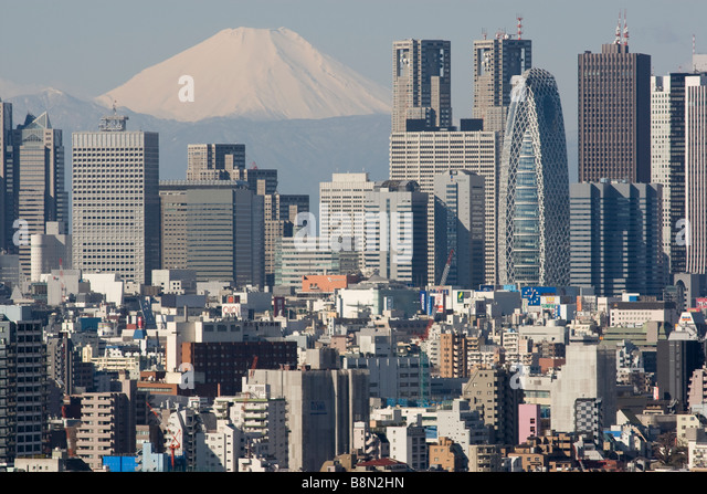 Mount Fuji and the Shinjuku district skyscraper skyline Tokyo Japan Monday 3rd March 2009 - Stock Image