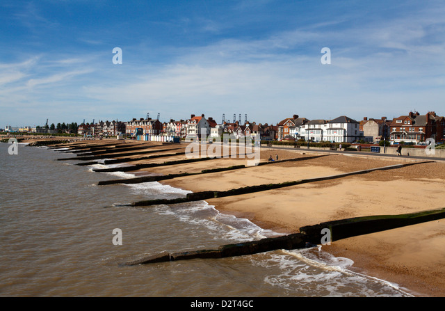 Felixstowe Beach from the pier with Container Port cranes in the distance, Felixstowe, Suffolk, England, United - Stock Image
