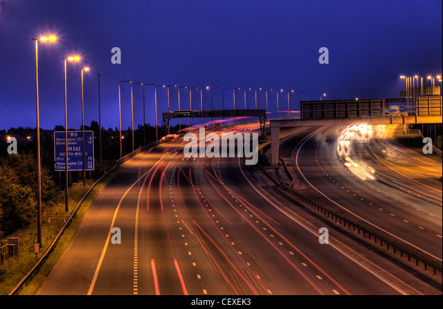 M6 Junction 21 at dusk, night shot slow exposure - Stock Image