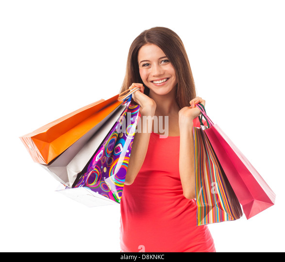 Cute woman shopping and smiling, isolated on white - Stock Image