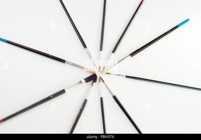 Illustrator paintbrushes on white background closeup - Stock Image
