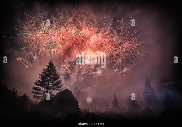 Fireworks into the forest in the amazing summer night, Waterfall Toce - Piedmont, Italy - Stock Image