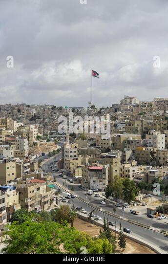 Amman city view with big Jordan flag and flagpole, Amman, Jordan - Stock Image