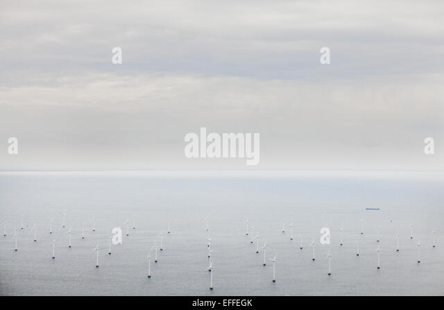 Aerial view of windmills in sea against sky - Stock Image