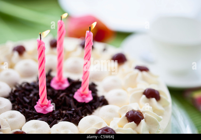 Black forest cake with candles, close-up - Stock-Bilder