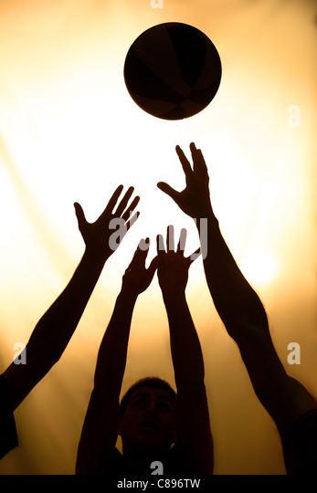 Basketball fight - black silhouettes of players - Stock Image