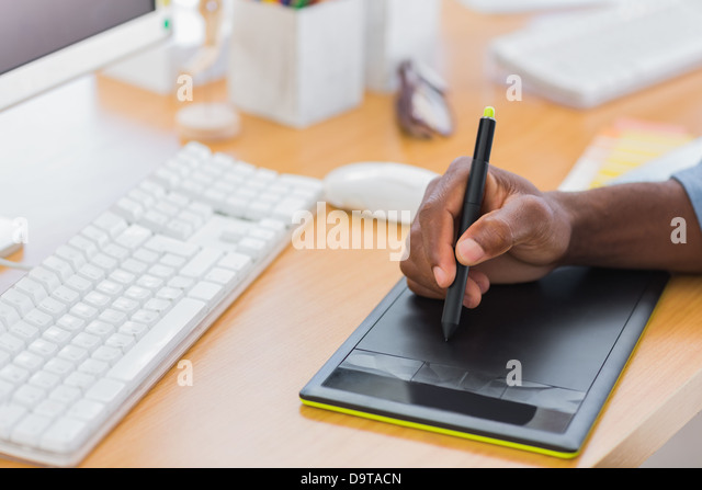 Close up of a graphic designer using graphics tablet - Stock-Bilder