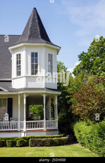 Monroeville Alabama Pineville Road historic homes Hybart home Queen Anne style columns wrap around porch turret - Stock Image