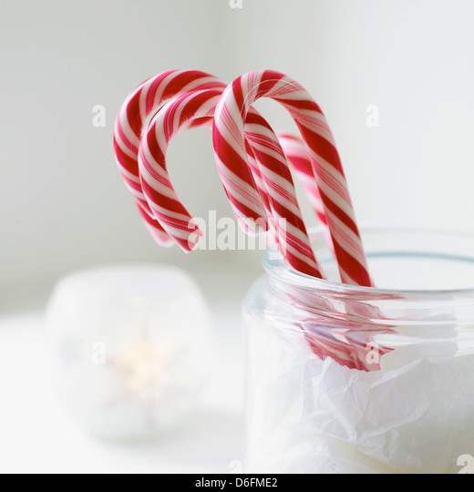 Christmas Candy Sticks in Glass Jar - Stock Image
