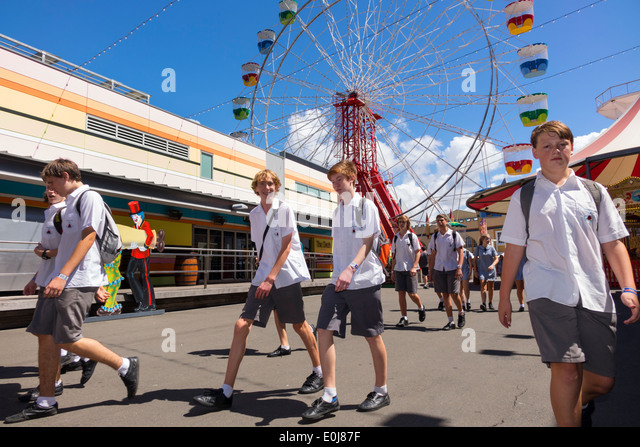 Sydney Australia NSW New South Wales Milsons Point Luna Park amusement Ferris Wheel student uniform teen boy class - Stock Image