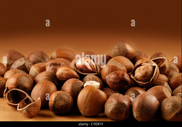 nuts  on a brown background - Stock Image