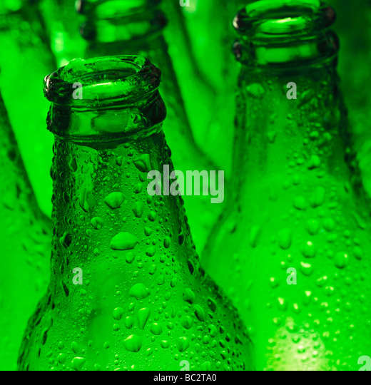 The close up of the bear bottles in water spots - Stock Image