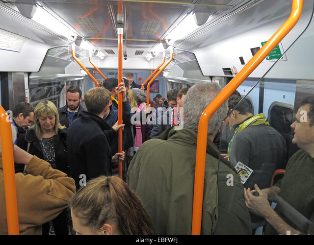 Overcrowded South West Train bound for London Waterloo railway station, England, UK - Stock Image