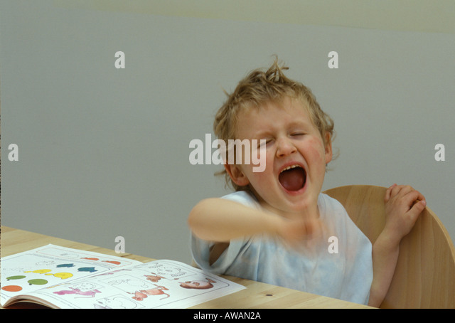 young boy shouting and waving his hands - Stock Image