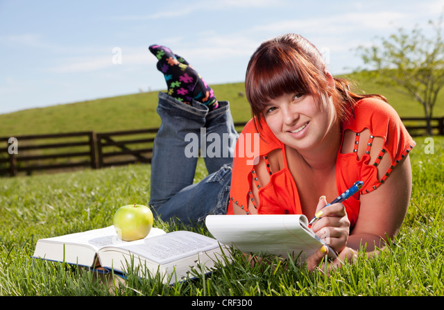 College student is studying outdoors - Stock Image