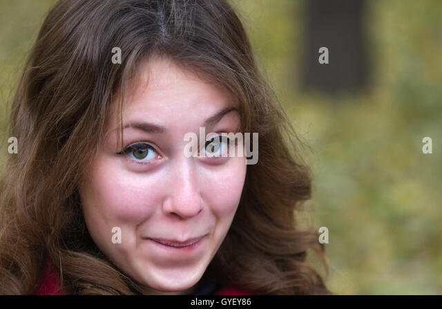 Portrait of an attractive beautiful pretty cute young caucasian embarassed astonished woman (girl, female, person, - Stock Image
