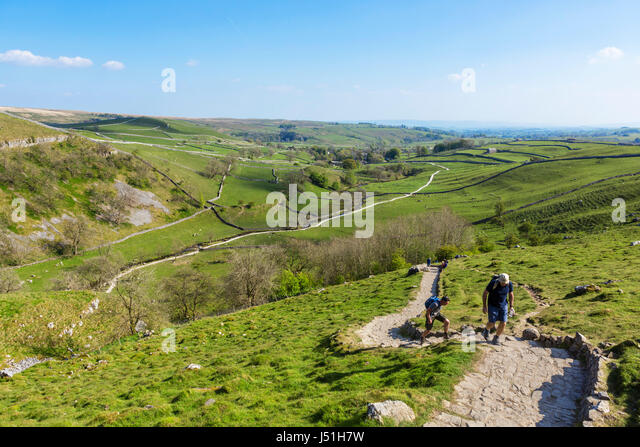 Walkers on the climb up to the top of Malham Cove, Malham, Malhamdale, Yorkshire Dales National Park, North Yorkshire, - Stock Image
