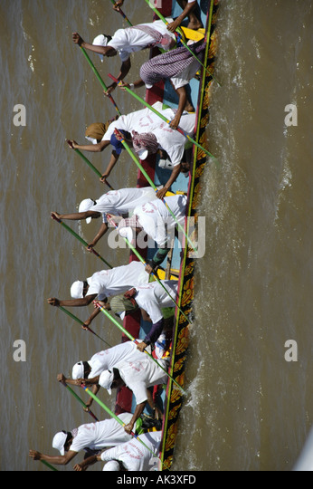 Big rowing boat with many men rowing Water Festival Phnom Penh Cambodia - Stock Image