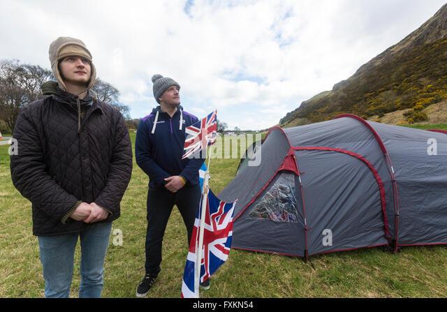Holyrood Park, Edinburgh, Scotland. 16th April, 2016. Neil Tannahill and James Woodward have set up a rival camp - Stock Image