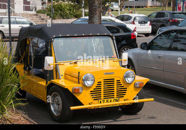 yellow Mini moke motor car parked in north sydney, australia - Stock Image