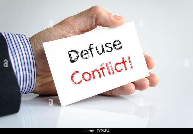 Defuse conflict text concept - Stock Image