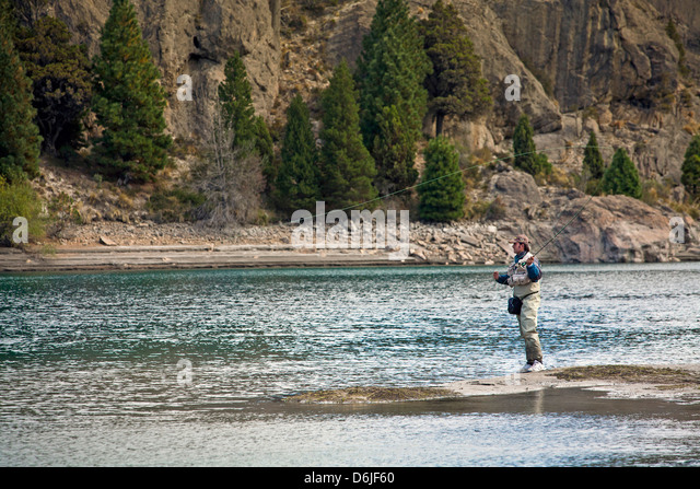 Fly fishing at the Limay River in the lake district, Patagonia, Argentina, South America - Stock Image