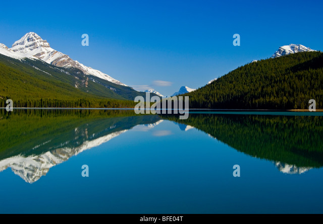 Mount Weed, at left, reflected in Lower Waterfowl Lake, Icefields Parkway, Banff National Park, Alberta, Canada - Stock Image