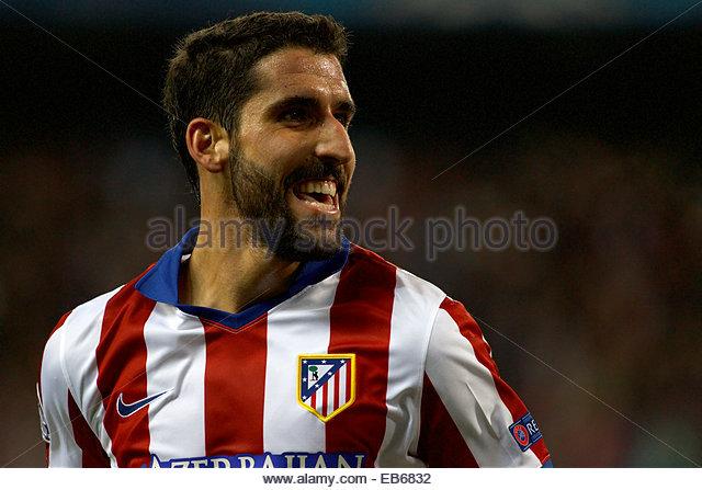 SPAIN, Madrid: Atletico de Madrid's Spanish midfielder Raul Garcia celebrates a goal during the Champions League - Stock Image