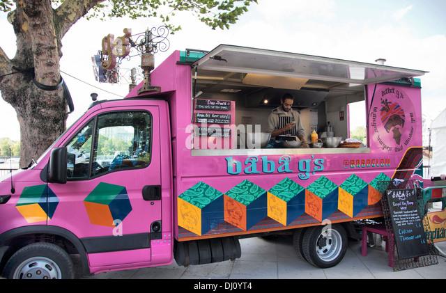 Pink Indian Gourmet Street food Van on Southbank Promenade in London UK - Stock Image