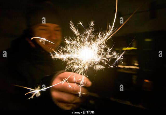 Man holding sparkle - Stock-Bilder
