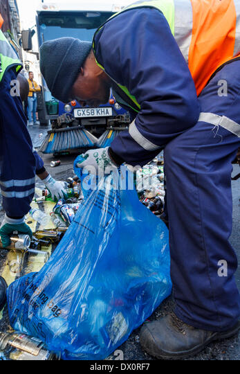 Council workers clear up debris from street party celebrations. London.  UK - Stock Image