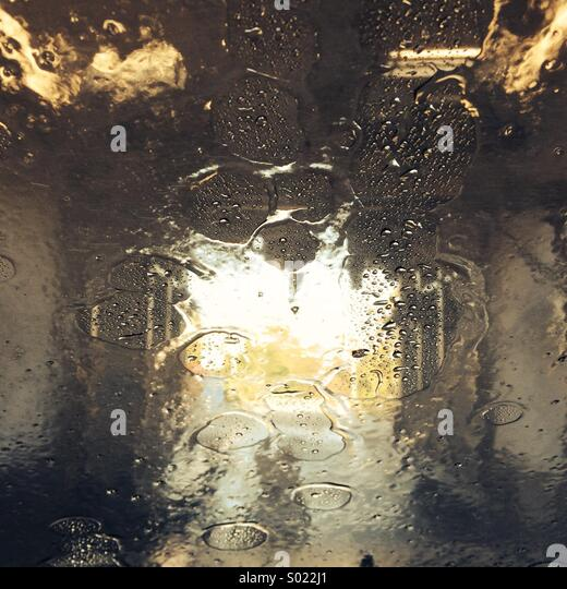 Going through the car wash - water on the windscreen - Stock Image