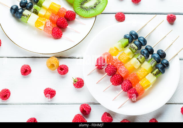 Fresh summer fruits on sticks - Stock-Bilder