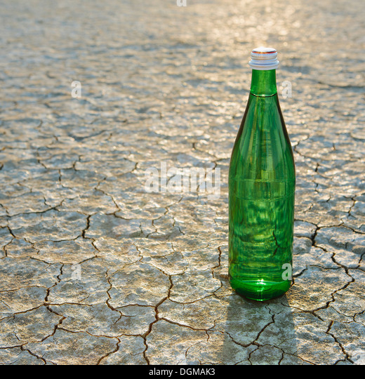 The landscape of the Black Rock Desert in Nevada. A bottle of water. Filtered mineral water. - Stock Image