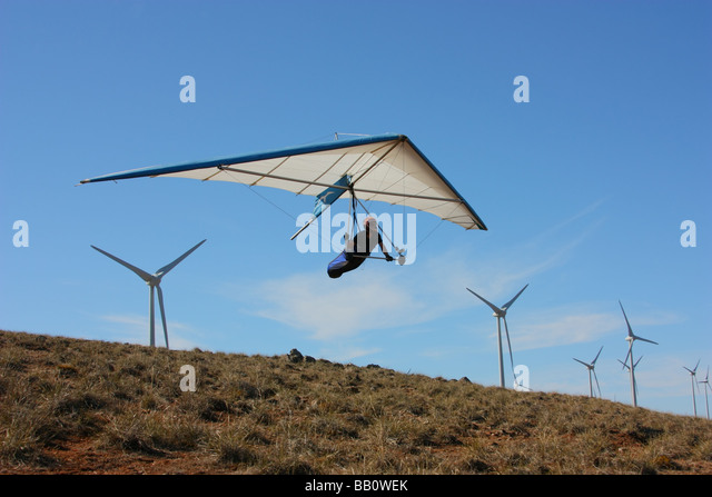 A hang glider banks to the left  in south Australia - Stock Image