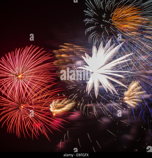 Colorful fireworks in night sky - Stock Image