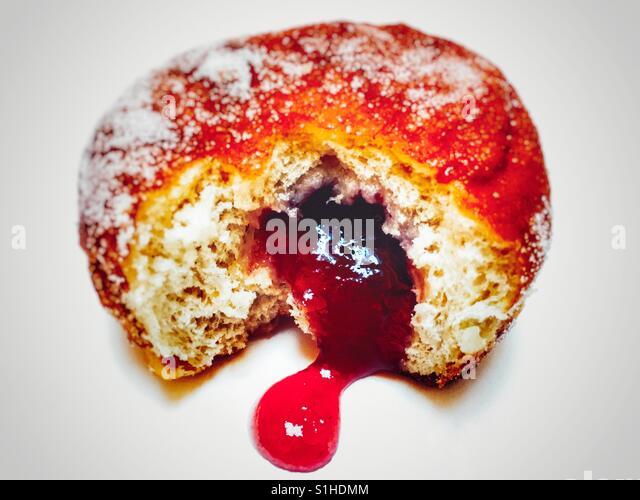 Strawberry jam doughnut - Stock Image