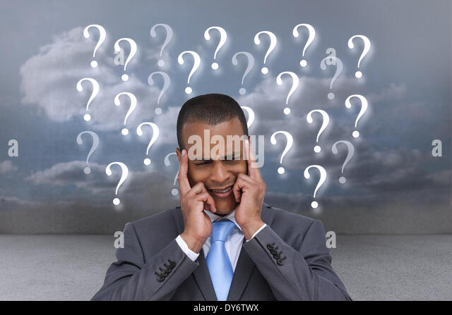 Composite image of stressed businessman putting his fingers on his temples - Stock Image
