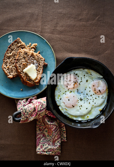 Plates of eggs and toast - Stock Image