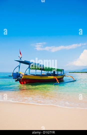 Traditional colourful Indonesian boat on the tropical island of Gili Meno, Gili Islands, Indonesia, Southeast Asia, - Stock Image