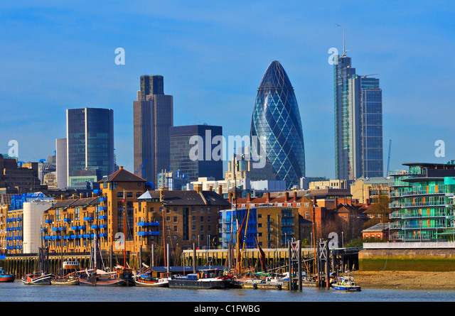 City of London skyline and Wapping seen from the Thames Path in Bermondsey, London, UK - Stock Image