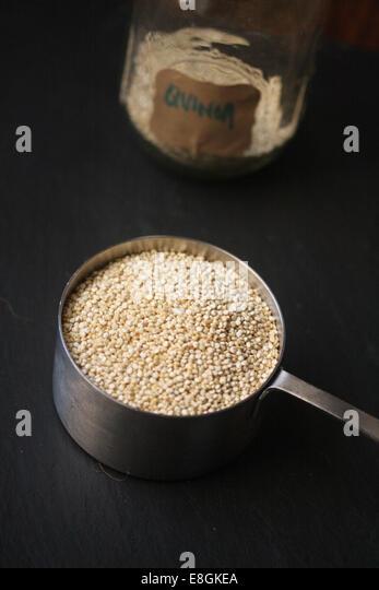 Quinoa in metal pot - Stock Image