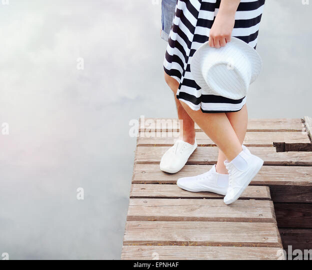 couple kissing on the pier near lake in hot summer day, summer concept - Stock-Bilder