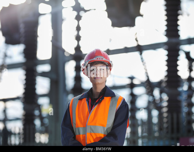 Female Worker At Power Station - Stock Image